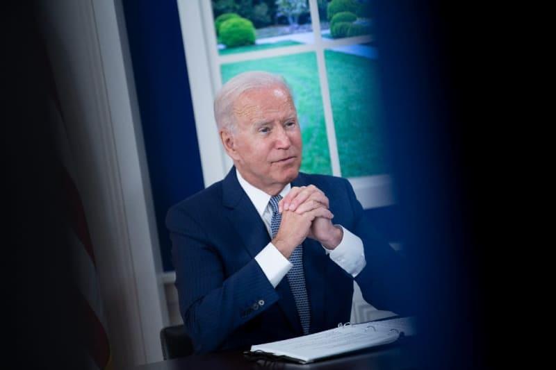 Biden tries to heal Democrats' divide on his spending plans